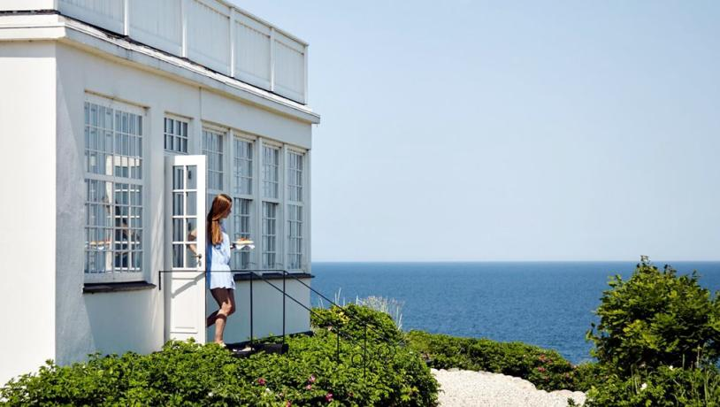 A woman walks out of Helenekilde Badehotel in North Zealand, Denmark