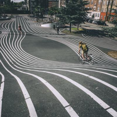 A cyclist speeds down the hill at Superkilen, Copenhagen, Denmark